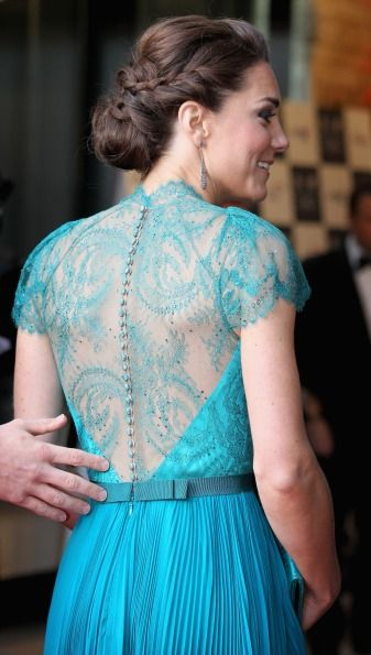 Stepping out with Will for the Olympics concert, Kate wore this gorgeous teal Jenny Packham dress with an intricate lace back. Almost exactly a year on from her wedding where she wowed in lacy Alexander McQueen, it seems like Kate knows what works for her whether she's dressing for her own wedding or a glamorous red carpet event.