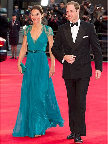 We're (jade) green with envy at Kate Middleton's latest red carpet look! The Duchess dazzled as she arrived at the Olympics concert in London. Not only do we love the beautiful chiffon pleated gown with lace cap sleeves embellished with Swarovski crystals and a bejewelled waistband, but we also heart Kate's new hairstyle: a braided bun! Gorge.