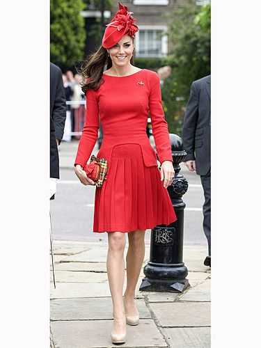 <p>Kate Middleton looked ravishing in red at the Diamond Jubilee pageant on the Thames during the Jubilee bank holiday weekend. The scarlet pleated McQueen dress was teamed with a matching hat, complete with a feather, and nude shoes (obvs! KMiddy loves them). GORGEOUS!</p>
