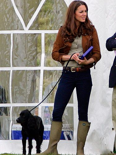 <p>Kate Middleton dressed for the great outdoors on a charity visit with children in the countryside. In contrast to the pomp and ceremony of the Trooping of the Colour, KMiddy opted for casual cool in blue Zara jeans, a khaki Burberry blouse, and matching Zara jumper layered under a Really Wild leather waistcoat. The Duchess also looked bootylicious in a pair of – get this - £300 wellies from French brand Le Chameau. We're ooh-la-loving Kate's off duty style!</p>