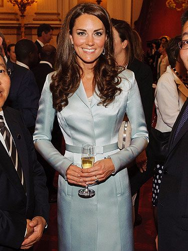 <p>For the 2012 Olympics opening ceremony reception at Buckingham Palace, Kate Middleton opted for a Christopher Kane outfit - and what a remarkable decision! The Duchess of Cambridge teamed her designer ensemble with bronzed skin, a KMiddy blow-dry and a celebratory glass of champers - LOVE.</p> <p>.</p>