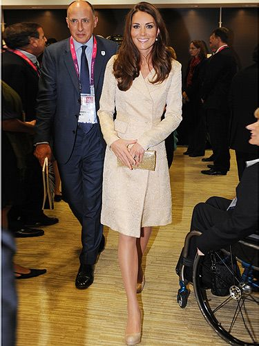 <p>Kate Middleton goes for gold at the Paralympics opening ceremony - maybe she's predicting a hefty gold medal haul for Team GB?</p> <p>She's certainly winning in the style stakes - the thrifty Duchess recycled the DAY Birger et Mikkelsen dress coat she wore to Zara Phillips' wedding last year - teamed with her face Kurt Geiger heels, natch.</p>