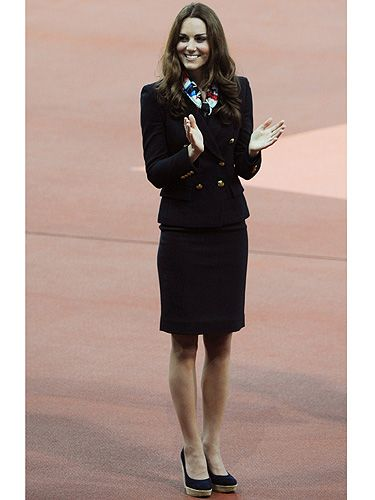 <p>Kate Middleton channels air stewardess chic as she hands out medals at the Olympic Stadium during the Paralympics.</p> <p>The Duchess wore a patterned Team GB scarf and a navy blazer teamed with a navy pencil skirt and her favourite Stuart Weitzman wedges.</p> <p>Hmm, we wonder whether she directed people to the nearest safety exits while she was there?</p>