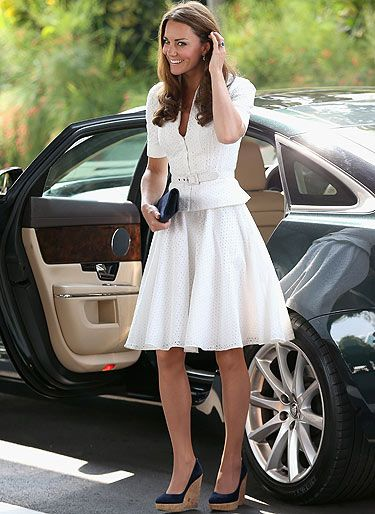 <p>Wow! Kate Middleton looked stunning in her pretty white Alexander McQueen broderie anglaise suit. On her feet she wore her fave navy suede Coco wedges by Stuart Weitzman for Russell & Bromley. Kate and her hubby are on a Diamond Jubilee Tour of the Far East taking in Singapore - LOVE!</p>