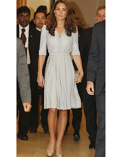 <p>We're loving that we get to see Kate Middleton in a fabulous new frock everyday as she tours Singapore for the Diamond Jubilee. Wearing another Jenny Packham dress (obviously one of her faves!) Kate showed off her famous ladylike style. Despite the fact it was an emotional day (Kate was visiting a war memorial site) the Duchess still kept things cool and stylish in this duck egg coloured dress with demure detailing. Adding her classic L.K.Bennet heels, Kate was the perfect picture!</p>