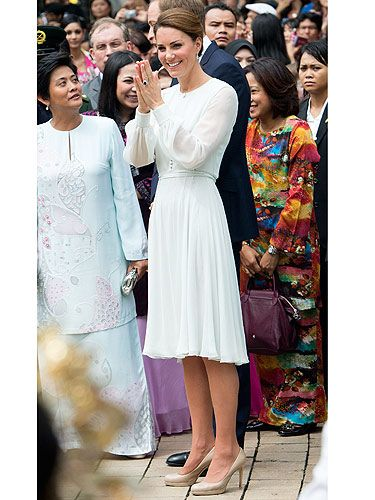 Kate Middleton continued on with her pastel silk trend, this time wearing Beulah London at another cultural event in Malaysia for the Diamont Jubilee tour. She looked royally prim and proper pulled her hair back in a low bun and her favourite nude LK Bennett pumps standing next to Prince William. Didn't they look smashing?