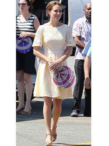 <p>Kate Middleton seems to have taken a shine to yellow frocks on her Diamond Jubilee Tour as she wore this cute eyelet dress by an independent dress maker. The Broderie Anglaise fabric and sweet pastel shade makes it perfect for the heat in Honiara as Kate embarks on the final leg of her and Prince William's Asia tour. She teamed her dress with a pair of Stuart Weitzman Minx wedges and a set of very elegant Kiki McDonough drop earrings. Kate also opted to tie her hair in a bun instead of her usual flowing waves - we're guessing the humidity was finally getting to her…</p>