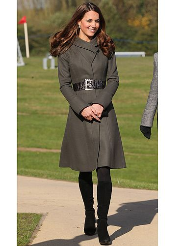 <p>What does one wear to meet the England football squad? Well, something warm and comfy if you're Kate Middleton. KMiddy met the squad in an olive green belted coat from Reiss and her trusty black knee-high boots. What, no nude heels?! Oh well, she still scored with us!</p>