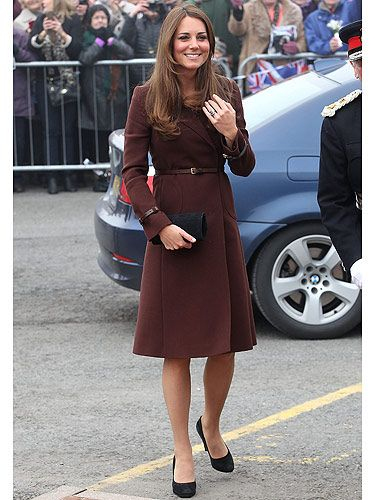 <p>The Duchess of Cambridge looks anything but grim in Grimsby. Baby mama-to-be Kate Middleton visited the National Fishing Heritage Centre looking lovely in a burgundy coat from Hobbs layered over a Great Plains dress. Apparently, the crowds were chanting, 'we want Kate!' as she arrived – well, we want Kate's wardrobe!</p>