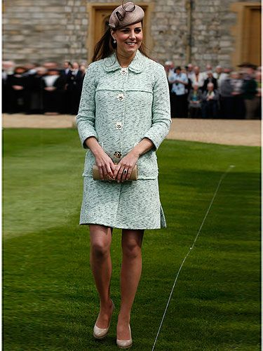 <p>There it is! Kate Middleton's growing baby bump is clearly visible under her gorge Mulberry mint coat as she attends the National Review of the Queen's Scouts at Windsor Castle. Despite being nearly 7 months pregnant, the Duchess of Cambridge still wore her trademark nude LK Bennett heels teamed with a taupe pillbox hat. We think she looks just swell, do you?</p>