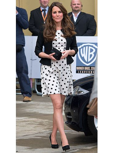 "<p>Kate Middleton has been a very busy bee this week. The Duchess wore this polka dot number at the inauguration of the Warner Bros Studios in Leavesden, Hertfordshire. She looks magical touring the Harry Potter set. Where's the dress from? Jenny Packham? L.K. Bennett? Nope, <a href=""http://www.topshop.com/webapp/wcs/stores/servlet/TopCategoriesDisplay?storeId=12556&catalogId=33057&geoip=home#slide1"" target=""_blank"">Topshop</a>. Uh huh, you can look like a princess for £38. She teamed the dress with plenty of black accessories. She's definitely cast a style spell on us.</p>"
