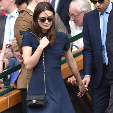 <p>When in doubt, take the Chanel bag. Always the Chanel. That are some round-rimmed sunnies give Keira's navy, long dress extra chic factor.</p>