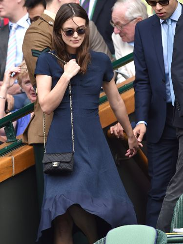 "<p>When in doubt, take the Chanel bag. Always the Chanel. That are some round-rimmed sunnies give Keira's navy, long dress extra chic factor.</p> <p><a href=""http://www.cosmopolitan.co.uk/fashion/news/red-carpet-dresses-serpentine-summer-party-2014"" target=""_blank"">CELEBS GLAM-UP FOR SERPENTINE GALLERY SUMMER PARTY</a></p> <p><a href=""http://www.cosmopolitan.co.uk/fashion/shopping/sports-luxe"" target=""_blank"">SPORTS LUXE PICKS FOR YOUR WEEKEND WARDROBE</a></p>"
