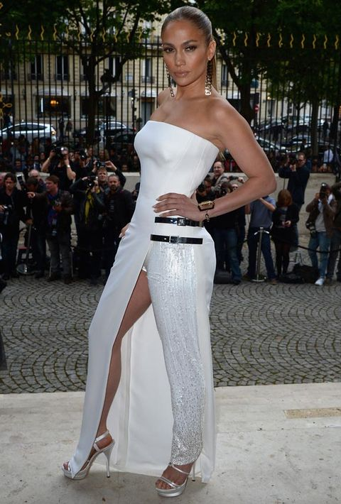 """<p>J.Lo is responsible for wearing the second most famous Versace dress ever, the first being Hurley's paperclip LBD, of course.</p> <p>And that moment at the Grammy Awards in 2000 put Jen and Versace in the fashion history books, creating a not-to-be-broken bond between star and designer.</p> <p>At this summer's haute couture show in Paris, J.Lo did what she does best and stunned in a new Versace creation. Not quite a jumpsuit, or a dress, this sparkling white number looked uber-sexy styled with J.Lo's slicked-back 'do and smouldering make-up.</p> <p><em><strong>See who else was at the Versace haute couture show in Paris and some of the best catwalk looks by clicking through the gallery...</strong></em></p> <p><a href=""""http://www.cosmopolitan.co.uk/fashion/news/fearne-cotton-wedding-dress-photos"""" target=""""_blank"""">FEARNE COTTON'S AMAZING WEDDING DRESS</a></p> <p><a href=""""Wimbledon%202014:%20the%20best%20celebrity%20fashion"""" target=""""_blank"""">WIMBLEDON 2014: THE BEST CELEB FASHION</a></p> <p><a href=""""http://www.cosmopolitan.co.uk/fashion/celebrity/david-victoria-beckham-style"""" target=""""_blank"""">STYLE FILE: 15 YEARS OF THE BECKHAMS</a></p> <p><em><strong><br /></strong></em></p>"""