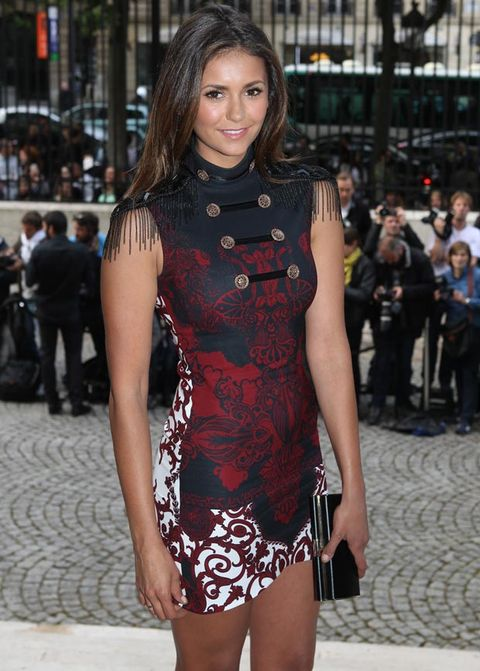 """<p>Nina Dobrev looked stylish in a red and navy military-inspired mini.</p> <p><a href=""""http://www.cosmopolitan.co.uk/fashion/news/fearne-cotton-wedding-dress-photos"""" target=""""_blank"""">FEARNE COTTON'S AMAZING WEDDING DRESS</a></p> <p><a href=""""Wimbledon%202014:%20the%20best%20celebrity%20fashion"""" target=""""_blank"""">WIMBLEDON 2014: THE BEST CELEB FASHION</a></p> <p><a href=""""http://www.cosmopolitan.co.uk/fashion/celebrity/david-victoria-beckham-style"""" target=""""_blank"""">STYLE FILE: 15 YEARS OF THE BECKHAMS</a></p>"""