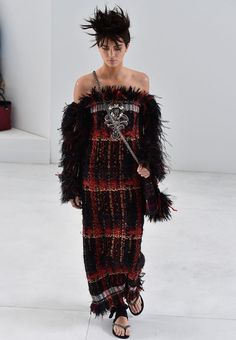 "<p>Over on the runway, Kendall made her Chanel couture catwalk debut in incredible style.</p> <p>The Keeping Up With The Kardashians star - and now bonafide high fashion model - wore a dark red and black knit dress with feathers sprouting from her sleeves.</p> <p><a href=""http://www.cosmopolitan.co.uk/fashion/news/paris-fashion-week-celebrities"" target=""_blank"">ALL THE FRONT ROW FASHION FROM PARIS</a></p> <p><a href=""http://www.cosmopolitan.co.uk/fashion/news/paris-fashion-week-versace"" target=""_blank"">J.LO WOWS IN WHITE AT VERSACE</a></p>"