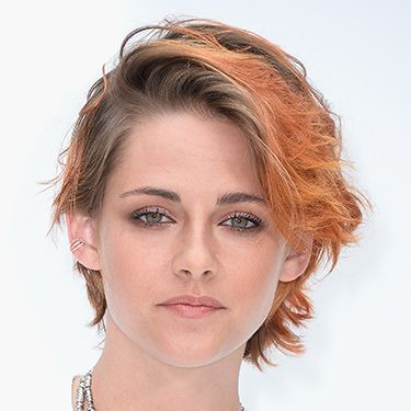 <p>Kristen's new crop is ultra-grungy, dyed copper orange with some serious rootage.</p>