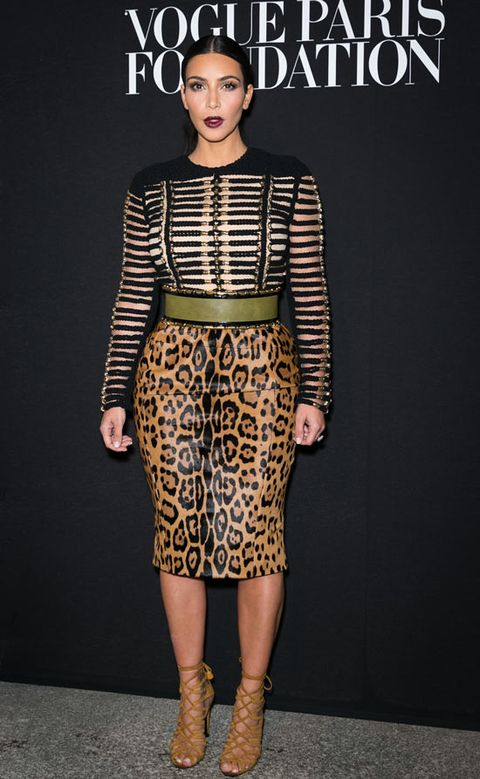 """<p>Kim has long been a fan of Balmain and even wore a custom dress by the label on her wedding day after changing out of her Valentino gown.</p> <p>We love this look on Kim: the slicked back hair, the dark lippy, the leather, the leopard print... so fierce and SO good.</p> <p><a href=""""http://www.cosmopolitan.co.uk/fashion/news/paris-fashion-week-celebrities"""" target=""""_blank"""">FABULOUS FRONT ROW CELEBRITY FASHION </a></p> <p><a href=""""http://www.cosmopolitan.co.uk/fashion/news/paris-fashion-week-street-style-2014"""" target=""""_blank"""">STYLE SNAPPED ON THE STREES OF PARIS</a></p>"""