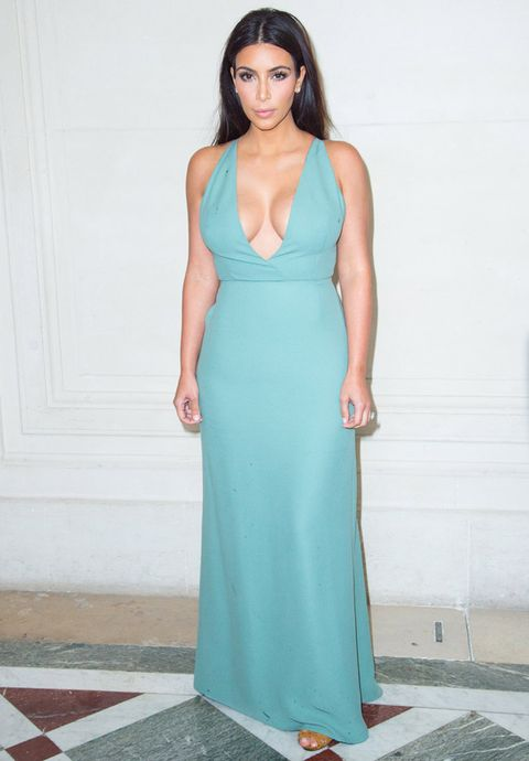 "<p>Having selected a Valentino gown for her marriage to Kanye West, we were not surprised to see the beautiful Kardashian taking her place on the front row at the brand's haute couture show.</p> <p>For the occasion, Kim looked lovely in a plunging, ice-blue gown and strappy, tan sandals.</p> <p>Later on, Kim attended the Vogue Foundation Gala wearing a design from her second-favourite label, Balmain.</p> <p><em><strong>Click through the gallery to see all the stars lining the front rows...</strong></em></p> <p><a href=""http://www.cosmopolitan.co.uk/fashion/celebrity/celebrity-style-gallery""><em><strong></strong></em>THIS WEEK'S BEST CELEBRITY STYLE</a></p> <p><a href=""http://www.cosmopolitan.co.uk/fashion/news/paris-fashion-week-versace"" target=""_blank"">J.LO STUNS IN SILVER AT VERSACE</a></p> <p><a href=""http://www.cosmopolitan.co.uk/fashion/shopping/celebrity-weddings-1"" target=""_blank"">AMAZING ALTERNATIVE CELEBRITY BRIDAL LOOKS</a></p>"