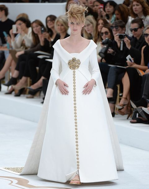 "<p>Pregancy bridal couture as imagined by Karl Largerfeld turns out to be a pretty special thing indeed. *Runs out, gets pregnant, buys Chanel, gets married*.</p> <p><a href=""http://www.cosmopolitan.co.uk/fashion/news/vogue-gala-paris-fashion-week"" target=""_blank"">KIM AND KENDALL'S BALMAIN ARMY</a></p> <p><a href=""http://www.cosmopolitan.co.uk/fashion/news/paris-fashion-week-celebrities"" target=""_blank"">WHAT THE STARS ARE WEARING ON THE FRONT ROW</a></p> <p><a href=""http://www.cosmopolitan.co.uk/fashion/news/paris-fashion-week-street-style-2014"" target=""_blank"">AMAZING STYLE FROM THE STREETS OF PARIS </a></p>"