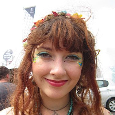 """<p><strong>Emily, 19, Bracknell</strong></p><p>With stick-on butterflies, bright blue eye shadow and a gorgeously colourful flower garland, Emily would have fit right in to Latitude's woods as one of the pixies.</p><p><a href=""""http://www.cosmopolitan.co.uk/beauty-hair/news/trends/celebrity-beauty/festivals-2014-makeup-hair-celebrity-inspiration"""" target=""""_blank"""">CELEB FESTIVAL BEAUTY INSPIRATION</a></p><p><a href=""""http://www.cosmopolitan.co.uk/beauty-hair/beauty-tips/hair-how-to-quiff-with-bun"""" target=""""_blank"""">HAIR HOW TO: THE QUICK QUIFF BUN</a></p><p><a href=""""http://www.cosmopolitan.co.uk/beauty-hair/beauty-tips/hair-how-to-quiff-with-bun"""" target=""""_blank"""">IS HAND ART THE NEW NAIL ART?</a></p><p><em><span class=""""s1"""">Peugeot celebrated the launch of the </span>New Peugeot 108 this weekend at Latitude</em></p>"""