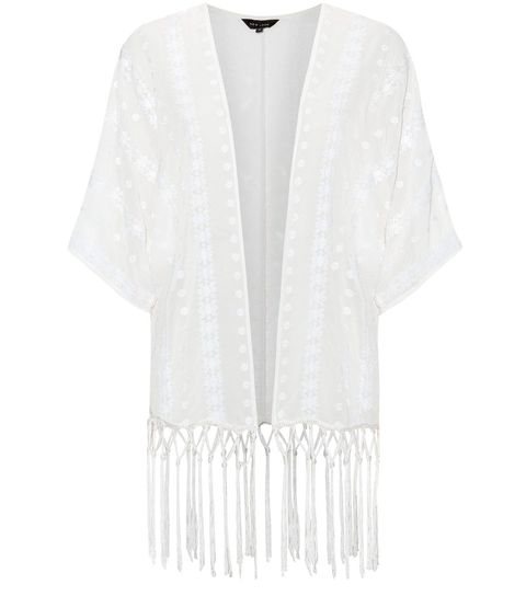 "<p><strong>The Cover Up</strong></p> <p><a href=""http://www.newlook.com/shop/womens/tops/cream-daisy-embroidered-tassel-hem-kimono-_306757812?extcam=AFF_AFW_Editorial+Content_ShopStyle+UK&awc=1946_1406125539_dfc60dc3a5cd038f320a81419a583b49"" target=""_blank"">A folky tasseled kimono</a> is a perfect piece to jet away with. Whether for lounging by the pool or late night cocktails, keeping the colour simple means it will go with everything.  </p> <p><a href=""http://www.cosmopolitan.co.uk/fashion/shopping/best-heels-shoes-summer-2014"" target=""_blank"">HOT TO TROT: SHOP SUMMER HEELS</a></p> <p><a href=""http://www.cosmopolitan.co.uk/fashion/shopping/best-mirrored-sunglasses"" target=""_blank"">13 AMAZING MIRRORED SUNNIES</a></p> <p><a href=""http://www.cosmopolitan.co.uk/fashion/shopping/best-summer-swimwear"" target=""_blank"">THE BEST ONE-PIECES TO BUY NOW</a></p>"