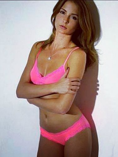 Millie Mackintosh looks a bit of all-bright in neon underwear!