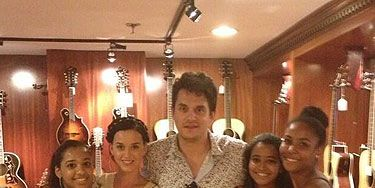 eb60fd44e John Mayer buys a fan an expensive guitar while out shopping with Katy Perry