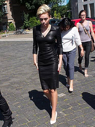 Miley Cyrus Wears Skin Tight Leather Dress In Sunny Germany