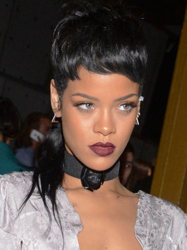 Rihanna wears a full,on mullet hairstyle  Showing off her