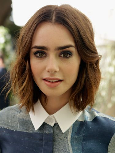Lily collins new bob hairstyle we love her messy bob hair just when we thought our obsession with lily collins hair couldnt reach new heights it did urmus Choice Image
