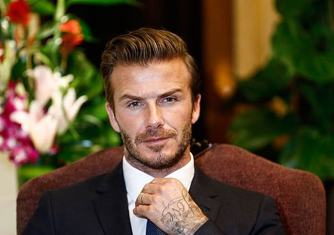<p>David Beckham is one of Britain's national treasures, but it's possible that China loves him even more than we do – okay, that's impossible but they are MASSIVE fans. Becks looked as handsome as ever while visiting Jiangsu Sainty Football Club at Nanjing Olympic Sports Centre this week. Now he's retired from football, we think he'd make a great James Bond if this picture is anything to go by. Come back DB, we miss you.</p>