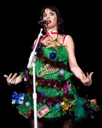 """<p>Screw all the Christmas jumpers that exist in the world, we want this Christmas tree dress right now to wear for every Christmas every year until the end of time. This is how it's done.</p><p><a href=""""http://www.cosmopolitan.co.uk/celebs/entertainment/katy-perry-first-ever-global-cover-star-july-2014"""" target=""""_blank"""">SEE KATY PERRY AS COSMO'S FIRST EVER GLOBAL COVER STAR</a></p><p><a href=""""http://www.cosmopolitan.co.uk/fashion/news/rita-ora-katy-perry-moschino-show?click=main_sr"""" target=""""_blank"""">RITA ORA AND KATY PERRY AT MILAN FASHION WEEK</a></p><p><a href=""""http://www.cosmopolitan.co.uk/beauty-hair/news/beauty-news/katy-perry-covergirl-advert?click=main_sr"""" target=""""_blank"""">KATY PERRY'S COVERGIRL ADVERT</a></p>"""