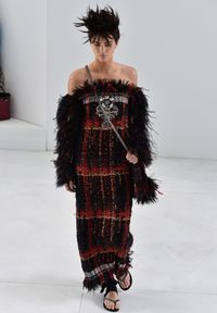 """<p>Over on the runway, Kendall made her Chanel couture catwalk debut in incredible style.</p><p>The Keeping Up With The Kardashians star - and now bonafide high fashion model - wore a dark red and black knit dress with feathers sprouting from her sleeves.</p><p><a href=""""http://www.cosmopolitan.co.uk/fashion/news/paris-fashion-week-celebrities"""" target=""""_blank"""">ALL THE FRONT ROW FASHION FROM PARIS</a></p><p><a href=""""http://www.cosmopolitan.co.uk/fashion/news/paris-fashion-week-versace"""" target=""""_blank"""">J.LO WOWS IN WHITE AT VERSACE</a></p>"""