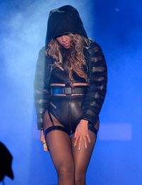 <p>Alexander Wang provided Beyoncé with one of the racier costumes for her show, a cut-out leather leotard, garter belt, hood and all.</p>