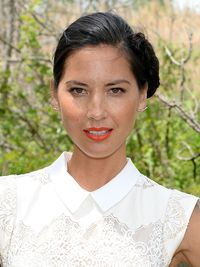 """<p>Go a little off-kilter with Olivia Munn's side bun, which is proof that changing one element can switch up your entire style. It's easy to do – a traditional bun simply erring on the edge – pair up with a punchy lip to lend a modern touch.</p><p><a href=""""http://www.cosmopolitan.co.uk/beauty-hair/beauty-tips/wedding-hair-inspiration-how-to-choose-hair-accessory?click=main_sr"""" target=""""_blank"""">HOW TO CHOOSE A WEDDING HAIR ACCESSORY</a></p><p><a href=""""http://www.cosmopolitan.co.uk/beauty-hair/news/styles/hair-trends-spring-summer-2014?click=main_sr"""" target=""""_blank"""">THE HUGE HAIR TRENDS FOR 2014</a></p><p><a href=""""http://www.cosmopolitan.co.uk/beauty-hair/news/beauty-news/how-to-do-festival-plait-hairstyle?click=main_sr"""" target=""""_blank"""">HAIR HOW-TO: FESTIVAL PLAITS</a></p>"""