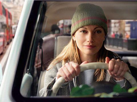 Cap, Hand, Beanie, Vehicle door, Headgear, Knit cap, Street fashion, Automotive mirror, Car seat, Bonnet,
