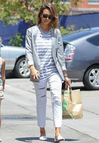 <p>White ripped jeans and a nautical nod with a Breton tee - ideal shopping spree attire.</p>