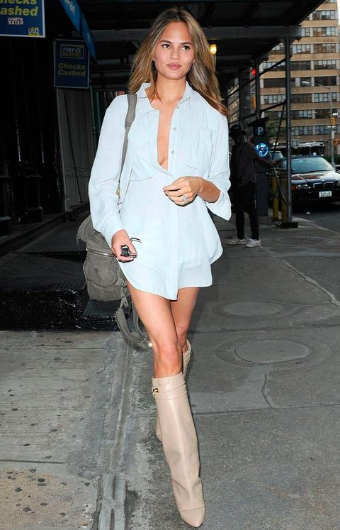 <p>Make like Chrissy and style your simple shirt sans bra, but <em>with</em> some statement, knee-high boots.</p>