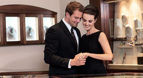 Coat, Shirt, Dress, Outerwear, Suit, Formal wear, Tie, White-collar worker, Suit trousers, Countertop,