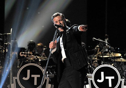 All pressed up in black and white, Justin Timberlake did show us a heefew things at the 2013 Grammy Awards. Mainly that he's stylish as well as a great singer. JT rocked a black Tom Ford suit and tie (sensing a theme?) with white shit and jazz shoes.