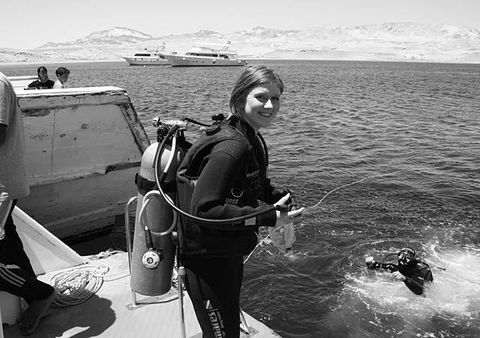 Water, Diving equipment, Divemaster, Personal protective equipment, Buoyancy compensator, Wetsuit, Watercraft, Ocean, Sea, Scuba diving,
