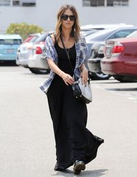 <p>Throw a short-sleeved, lightweight check shirt over a plain maxi dress to add some attitude to your daytime casual look.</p>