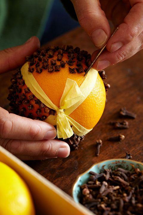 Finger, Yellow, Ingredient, Food, Citrus, Fruit, Natural foods, Nail, Produce, Flowering plant,