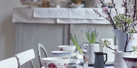 <p>A mismatched collection of china, combining graphic stripes, trailing florals and other small-scale patterns like the one above, instantly adds charm and decoration to a white tablecloth and pared-back pale scheme. Easily combine both new and vintage pieces by choosing patterns that link by colour, sticking to one or two shades such as this soft red and mid-blue for a relaxed and calm feel.</p>