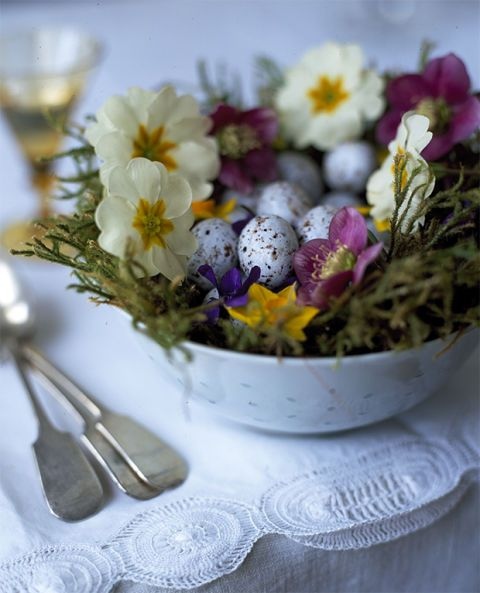 "<p>An eye-catching singular flower display, or a group of arrangements in a collection of vessels, can create a beautiful centrepiece for a special occasion. Above, a large ceramic bowl filled with moss, primulas, violets and hellebores surrounding small speckled eggs makes a colourful springtime display. Enamel buckets or teapots, along with vintage wooden crates can also make interesting pots to plant up with seasonal blooms.</p><p><strong><a href=""http://www.countryliving.co.uk/homes-interiors/interiors/make-rustic-flower-display"">How to create a rustic flower display</a></strong></p>"