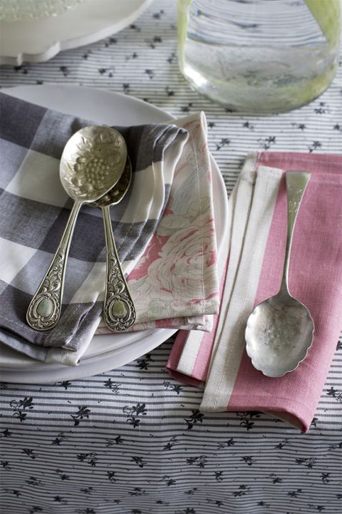 "<p>Turn colourful fabric remnants into unique table-linens like those shown above to partner with plain crockery. Pretty designs such as florals or sprigged motifs combine well with more contrasting graphic checks and stripes, but the beauty of this idea is, it can be tailored to suit your taste, guests or simply the season and can incorporate as many or as few different fabrics as you wish. Linen and cotton work best for this, as they wash well and can be reused.</p><p><strong><a href=""http://www.countryliving.co.uk/create/craft/how-to-make-napkins"">How to make your own napkins</a></strong></p>"