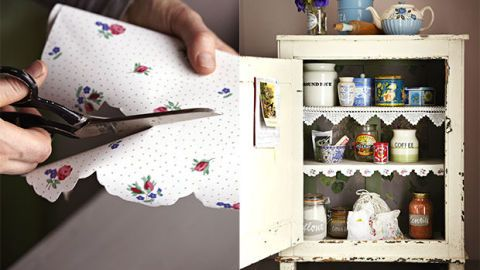 Cupboard with wallpaper lining and scissors