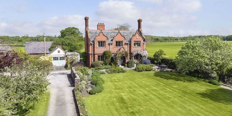Mill Hill House in Cheshire with lawn and drive to side