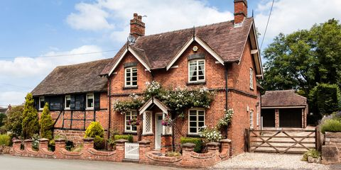 Red brick Victorian cottage with five bar gate at side